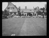 view [Orchard Farm]: looking across a lawn to the house and terrace. digital asset: [Orchard Farm] [lantern slide]: looking across a lawn to the house and terrace.
