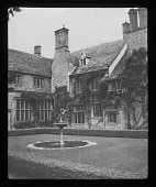 view [Notgrove Manor]: house, fountain, and hedge-enclosed lawn. digital asset: [Notgrove Manor] [lantern slide]: house, fountain, and hedge-enclosed lawn.