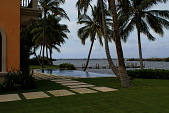 view [Palm Beach Garden]: The infinity pool appears to spill into Lake Worth with palms overhead and gardenia hedges surrounding the pool. digital asset: [Palm Beach Garden]: The infinity pool appears to spill into Lake Worth with palms overhead and gardenia hedges surrounding the pool.: 2016 Apr.
