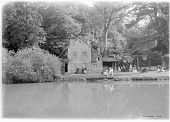 view [Versailles]: a site in the Hameau de la Reine, Marie Antoinette's rustic, faux country village in the Versailles park. digital asset: [Versailles] [glass negative]: a site in the Hameau de la Reine, Marie Antoinette's rustic, faux country village in the Versailles park.