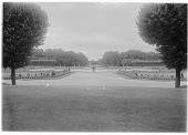 view [Fontainebleau]: part of the formal garden of the château, with the Grand Canal barely visible in the distance. digital asset: [Fontainebleau] [glass negative]: part of the formal garden of the château, with the Grand Canal barely visible in the distance.