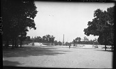 view [Tuileries Garden]: looking from the Tuileries Garden through the Fer à Cheval toward the Place de la Concorde. digital asset: [Tuileries Garden] [negative]: looking from the Tuileries Garden through the Fer à Cheval toward the Place de la Concorde.
