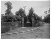 view [Miscellaneous Sites in France, Series 1]: brick wall, gate, and road in an unidentified location. digital asset: [Miscellaneous Sites in France, Series 1] [glass negative]: brick wall, gate, and road in an unidentified location.
