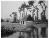 view [Manoir d'Archelles and Vicinity]: looking west, showing outbuildings of the manor, with the La Béthune River in the foreground. digital asset: [Manoir d'Archelles and Vicinity] [glass negative]: looking west, showing outbuildings of the manor, with the La Béthune River in the foreground.