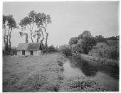 view [Manoir d'Archelles and Vicinity]: looking north, showing the La Béthune River and outbuildings of the manor, with the manor house out of view on the right. digital asset: [Manoir d'Archelles and Vicinity] [glass negative]: looking north, showing the La Béthune River and outbuildings of the manor, with the manor house out of view on the right.