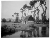 view [Manoir d'Archelles and Vicinity]: a barn or outbuilding and fields, with the La Béthune River in the foreground. digital asset: [Manoir d'Archelles and Vicinity] [glass negative]: a barn or outbuilding and fields, with the La Béthune River in the foreground.