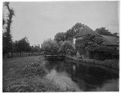 view [Manoir d'Archelles and Vicinity]: looking north, showing the La Béthune River, with one of the manor's barns or outbuildings on the right. digital asset: [Manoir d'Archelles and Vicinity] [glass negative]: looking north, showing the La Béthune River, with one of the manor's barns or outbuildings on the right.