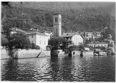 view [Miscellaneous Sites in the Italian Lakes]: the town of Torno along Lake Como, with the tower of the Church of St. Tecia in the center of the image. digital asset: [Miscellaneous Sites in the Italian Lakes] [glass negative]: the town of Torno along Lake Como, with the tower of the Church of St. Tecia in the center of the image.
