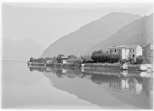 view [Miscellaneous Sites in the Italian Lakes]: Lake Lugano looking north, with part of the village of Osteno on the right. digital asset: [Miscellaneous Sites in the Italian Lakes] [glass negative]: Lake Lugano looking north, with part of the village of Osteno on the right.