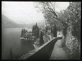 view [Miscellaneous Sites in the Italian Lakes]: the town of Varenna on Lake Como, showing the Lovers' Walk and the Chiesa di San Giorgio. digital asset: [Miscellaneous Sites in the Italian Lakes] [lantern slide]: the town of Varenna on Lake Como, showing the Lovers' Walk and the Chiesa di San Giorgio.