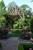 view [Reed and Stacey Dillon Residence]: the Adirondack style pergola built from Osage orange limbs suports climbing roses and clematis. digital asset: [Reed and Stacey Dillon Residence]: the Adirondack style pergola built from Osage orange limbs suports climbing roses and clematis.: 2012 Jun.