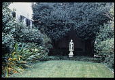 view [Strachan Garden]: Chinese sculpture (Goddess of Mercy) on the terrace framed by clipped shrubs. digital asset: [Strachan Garden]: Chinese sculpture (Goddess of Mercy) on the terrace framed by clipped shrubs.: 1987 October 1