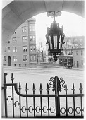 view [Harvard University]: the corner of Bow Street and Massachusetts Avenue in Cambridge, viewed from a gate of Harvard University. digital asset: [Harvard University] [glass negative]: the corner of Bow Street and Massachusetts Avenue in Cambridge, viewed from a gate of Harvard University.