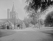 view [Mount Auburn Cemetery]: Story Chapel and the cemetery seen from the main cemetery entrance on Mt. Auburn Street. digital asset: [Mount Auburn Cemetery] [glass negative]: Story Chapel and the cemetery seen from the main cemetery entrance on Mt. Auburn Street.