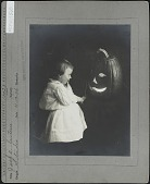 view Child with Jack-o-lantern digital asset: Child with Jack-o-lantern [photoprint]