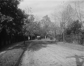 view [Roland Park]: an unidentified dirt road and early 20th century automobiles. digital asset: [Roland Park] [glass negative]: an unidentified dirt road and early 20th century automobiles.