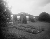 view [Edgewood (MD)]: pergola, tapis vert, and flower beds and borders. digital asset: [Edgewood (MD)] [glass negative]: pergola, tapis vert, and flower beds and borders.
