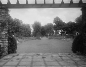 view [Edgewood (MD)]: looking from the pergola across the tapis vert toward stone stairs and the house. digital asset: [Edgewood (MD)] [glass negative]: looking from the pergola across the tapis vert toward stone stairs and the house.