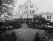 view [Marengo]: looking from the garden to the house and its awning-shaded porch. digital asset: [Marengo] [glass negative]: looking from the garden to the house and its awning-shaded porch.
