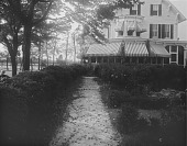 view [Marengo]: looking toward the house and its awning-shaded porch from the garden, with an unidentified person on the far left. digital asset: [Marengo] [glass negative]: looking toward the house and its awning-shaded porch from the garden, with an unidentified person on the far left.