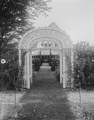 view [Marengo]: one of the arbors, with the house in the background. digital asset: [Marengo] [glass negative]: one of the arbors, with the house in the background.
