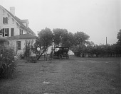 view [Marengo]: back of house and grassy area, with vintage automobile, before landscaping. digital asset: [Marengo] [glass negative]: back of house and grassy area, with vintage automobile, before landscaping.