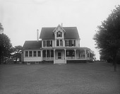 view [Marengo]: the house and its wraparound porch, before landscaping. digital asset: [Marengo] [glass negative]: the house and its wraparound porch, before landscaping.