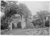 view [Marengo]: the rose garden and one of the arbors, with the house and pergola in the background. digital asset: [Marengo] [glass negative]: the rose garden and one of the arbors, with the house and pergola in the background.