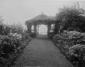 view [Holly Beach Farm]: garden borders and the rustic gazebo overlooking the Chesapeake Bay. digital asset: [Holly Beach Farm] [glass negative]: garden borders and the rustic gazebo overlooking the Chesapeake Bay.