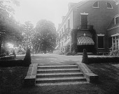 view [Holly Beach Farm]: looking up the brick stairs from the lawn to the house and its grass terrace. digital asset: [Holly Beach Farm] [glass negative]: looking up the brick stairs from the lawn to the house and its grass terrace.