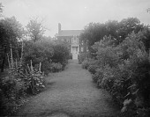 view [Ridout House]: grass walkway in garden leading up to the house. digital asset: [Ridout House] [glass negative]: grass walkway in garden leading up to the house.