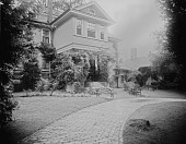view [Bordley-Randall House]: part of the house and grounds, with a brick walkway and garden furniture, facing what is now Randall Court. digital asset: [Bordley-Randall House] [glass negative]: part of the house and grounds, with a brick walkway and garden furniture, facing what is now Randall Court.