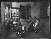 view [Tanglewood]: people sitting on porch, with Dr. Gustav Adolph Liebig, Jr., and his camera in the background. digital asset: [Tanglewood] [glass negative]: people sitting on porch, with Dr. Gustav Adolph Liebig, Jr., and his camera in the background.