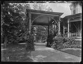 view [Tanglewood]: a man and two boys under the porte-cochere. digital asset: [Tanglewood] [glass negative]: a man and two boys under the porte-cochere.