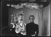 view [Miscellaneous Images in Maryland]: an unidentified man and woman posing in front of a backdrop. digital asset: [Miscellaneous Images in Maryland] [glass negative]: an unidentified man and woman posing in front of a backdrop.