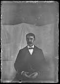 view [Miscellaneous Images in Maryland]: an unidentified man posing in front of a backdrop. digital asset: [Miscellaneous Images in Maryland] [glass negative] an unidentified man posing in front of a backdrop.
