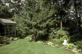 view [The Cottage Garden]: side garden by house with garden border and female statue. digital asset: [The Cottage Garden]: side garden by house with garden border and female statue.: 2004 Jul.