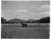 view [Miscellaneous Sites in New Hampshire, Series 1]: a horse-drawn hay mower in a field in Intervale, New Hampshire, with hills and mountains toward the north. digital asset: [Miscellaneous Sites in New Hampshire, Series 1] [glass negative]: a horse-drawn hay mower in a field in Intervale, New Hampshire, with hills and mountains toward the north.