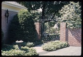 view [Vernon Manor II]: bird bath and ornamental iron gate at right front of house. digital asset: [Vernon Manor II] [safety film negative]: bird bath and ornamental iron gate at right front of house.