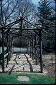 view [Lodeb]: rustic arbor with tennis court behind. digital asset: [Lodeb]: rustic arbor with tennis court behind.: 2002 Apr.