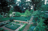view [Thomas Garden, The]: formal garden from second floor, with tennis court in upper right. digital asset: [Thomas Garden, The]: formal garden from second floor, with tennis court in upper right.: 1999 Jun.