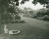 view [Peters Garden]: garden elf, birdbath, and borders leading to house. digital asset: [Peters Garden] [photographic print]: garden elf, birdbath, and borders leading to house.