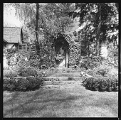 view [Auchincloss Garden]: looking up from sunken garden to ivy-covered niche with wall fountain. digital asset: [Auchincloss Garden] [contact print]: looking up from sunken garden to ivy-covered niche with wall fountain.