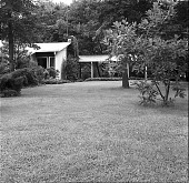 view [Gleason Garden]: view of house and landscaping from the Erskine Drive side of the property. digital asset: [Gleason Garden] [safety film negative]: view of house and landscaping from the Erskine Drive side of the property.