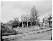 view [Miscellaneous Sites in the Adirondack Mountains]: a house at what is now 318 Ampersand Avenue (formerly 12 Ampersand Avenue) in the village of Saranac Lake. digital asset: [Miscellaneous Sites in the Adirondack Mountains] [glass negative]: a house at what is now 318 Ampersand Avenue (formerly 12 Ampersand Avenue) in the village of Saranac Lake.