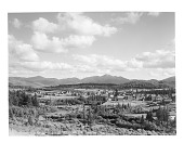 view [Miscellaneous Sites in the Adirondack Mountains]: a view toward the High Peaks over part of the village of Lake Placid, with the Chubb River visible in the left foreground of the image. digital asset: [Miscellaneous Sites in the Adirondack Mountains] [glass negative]: a view toward the High Peaks over part of the village of Lake Placid, with the Chubb River visible in the left foreground of the image.