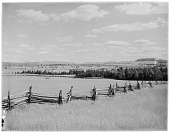 view [Miscellaneous Sites in the Adirondack Mountains]: looking across fields and farms toward the distant High Peaks, from an unidentified location in the vicinity of Lake Placid. digital asset: [Miscellaneous Sites in the Adirondack Mountains] [glass negative]: looking across fields and farms toward the distant High Peaks, from an unidentified location in the vicinity of Lake Placid.