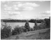 view [Miscellaneous Sites in the Adirondack Mountains]: Mirror Lake in Lake Placid, with the High Peaks in the distance. digital asset: [Miscellaneous Sites in the Adirondack Mountains] [glass negative]: Mirror Lake in Lake Placid, with the High Peaks in the distance.