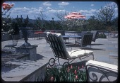 view [Cole Garden]: view of patio with outdoor furniture and urn. digital asset: [Cole Garden] [slide (photograph)]: view of patio with outdoor furniture and urn.