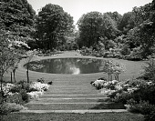 view [Kiluna Farm]: reflecting pool, showing surrounding plantings and grass steps. digital asset: [Kiluna Farm] [slide]: reflecting pool, showing surrounding plantings and grass steps.